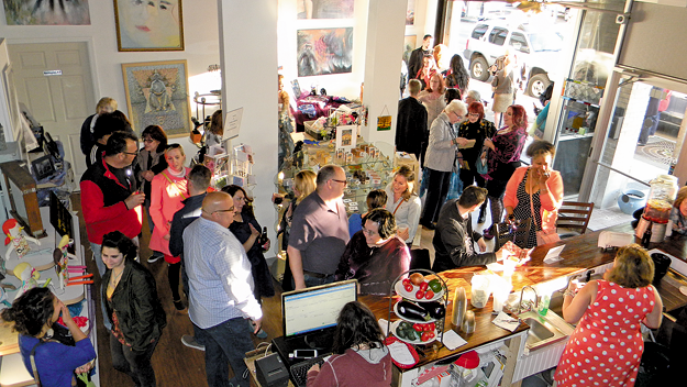A view of the May grand opening at the 24 Below Gallery and Café. (Photo by Terry Duffy)