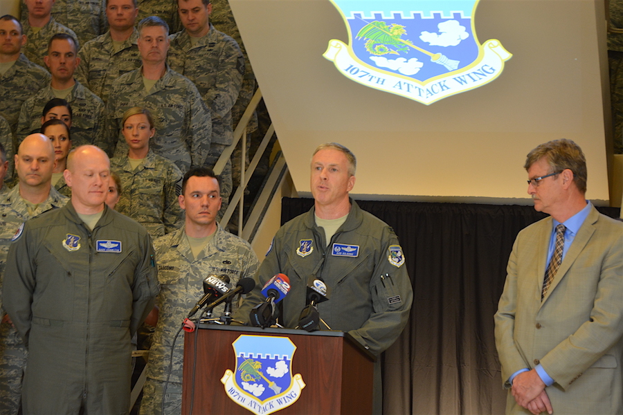 Col. Robert Kilgore, commander of the 107th Attack Wing, speaks about the wing's name change to members of the wing and local officials.