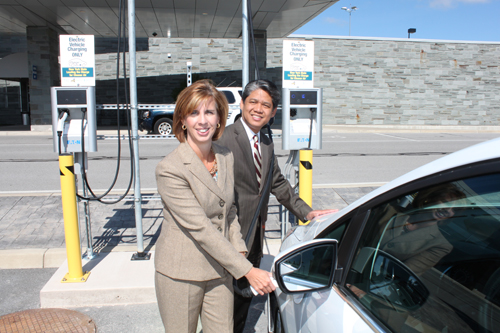 Shown, at the new Niagara Falls International Airport charging stations are Kim Minkel, NFTA executive director and Gil C. Quiniones, NYPA president and CEO.
