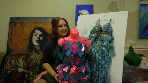 NACC artist Mary Grace O, shown with some of her fashions to be featured at Thursday's Wearable Art Show. Dresses made from recycled materials will highlight the Aquarium of Niagara benefit.