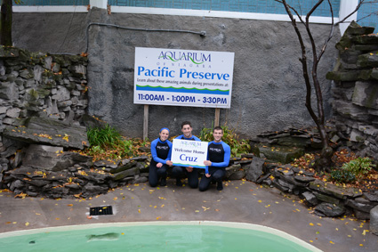 Aquarium of Niagara members Hallie, James and Michael welcome Cruz.