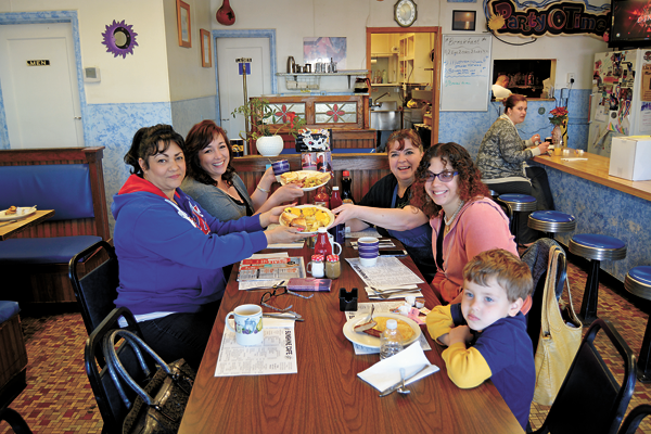 Family and friends dine at the Sunshine Café at Buffalo Avenue. Sitting from front to back, on left, is Dolores Johnson of Niagara Falls and Christine Briceno of Sacramento (with family native to Niagara Falls). Sitting from front to back, at right, are Ebenezer and Malissa Eldridge of Niagara Falls and Sunshine Café owner Lisa Routhier.
