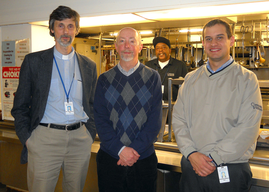 Front, from left: Rev. Mark Breese, the Rev. Jim Kelsey (executive minister, ABCNYS) and Christian Hoffman (development manager for CMI). Background: Jimmie Walker (CMI cook). One-on-one ministry is practiced daily in Community Mission's community soup kitchen in Niagara Falls.