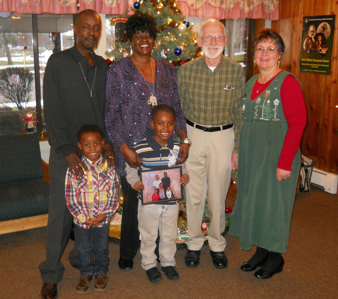 Leon and Betty Street are joined by their grandsons, Tremir and Morlow, and by photographers Bob and Jan Inwards, who provided free portraits during the holiday season at Community Missions.