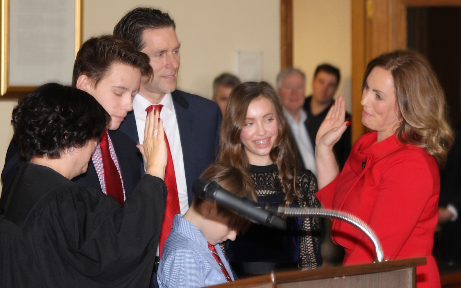 Niagara County District Attorney Caroline A. Wojtaszek is sworn in at the Niagara County Courthouse by County Judge Sara Sheldon Dec. 31 as her husband, Henry, daughter, Katie, and sons Jack and Ryan look on. Wojtaszek previously served as Sheldon's law clerk.