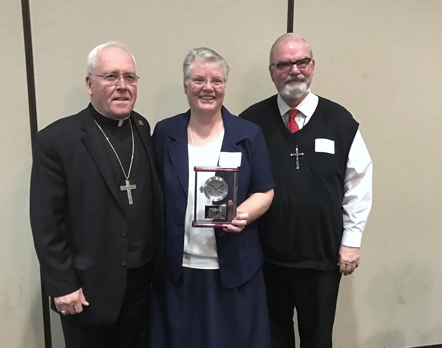 Sister Nora Sweeney stands with Bishop Richard J. Malone and her brother, Brother Thomas Sweeney, after receiving the Catholic Charities Hero of Hope award.