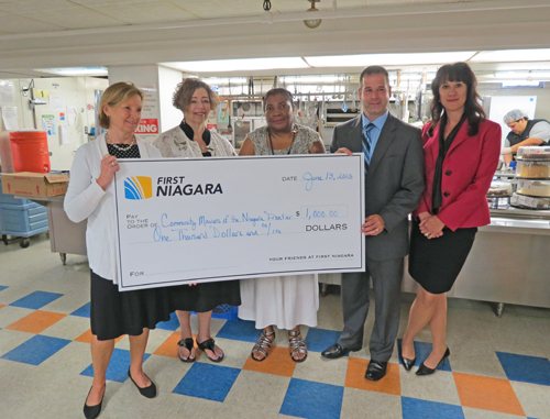 Pictured from left are Elizabeth Gurney, executive director of the First Niagara Foundation; Robyn L. Krueger, executive director of Community Missions of Niagara Frontier; Wanda DeBose, community/crisis services supervisor of Community Missions; Michael Noah, First Niagara vice president, business banking; and Annette Tomlin, Niagara Falls First Niagara branch manager. (photo by Joshua Maloni)