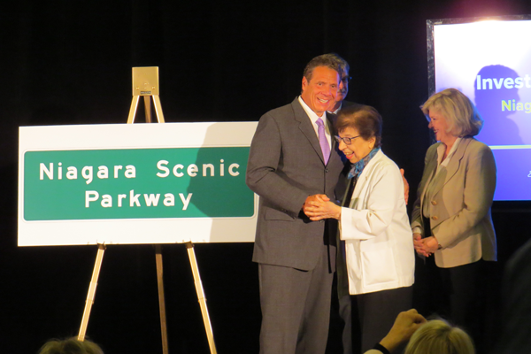 Gov. Andrew Cuomo congratulates Mamie Simonson on the renaming of the Robert Moses Parkway to Niagara Scenic Parkway. (Photos by Joshua Maloni)