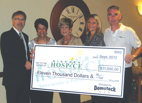 Pictured from left are Niagara Hospice Medical Director Dr. AJ Bax and Clinical Director Janet Ligammari as they accept a generous $11,000 donation from All Metals Works `Domstock` event organizers Deborah Holliday, Jennifer Blake and owner Dominick Ciliberto.