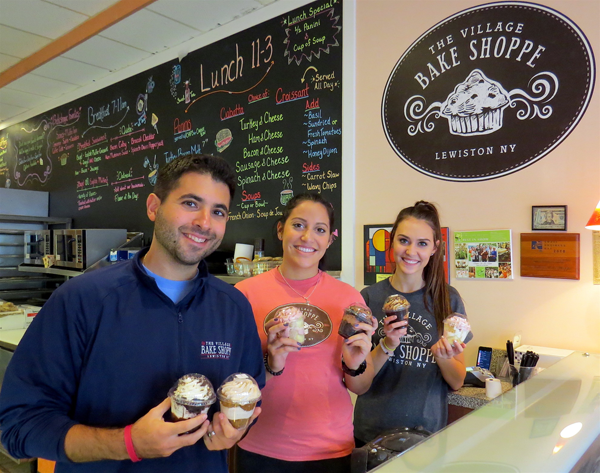 The Village Bake Shoppe will donate $1 from every `Cake in a Cup` purchase to Community Missions. Pictured, from left, are owner Mike Fiore with employees Annmarie Catalano and Corrinna Dompkowski.