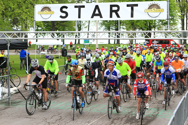 Riders are shown at the start of the Hospice Gran Fondo.