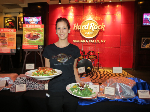 Hard Rock Café, Niagara Falls USA, server Carly Finitz shows off some of the restaurant's new menu items.
