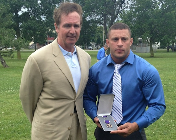 Congressman Brian Higgins, left, stands with U.S. Army Staff Sgt. Andrew Bluhm.