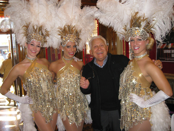 Niagara Hospice volunteer Roland Rosati of Lewiston stops to pose with the performers of `Viva Las Vegas` at the Riviera Theatre in North Tonawanda during a recent Niagara Hospice volunteer appreciation event.