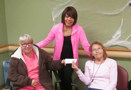 Pictured with the $550 American Cancer Society donation check are, from left, Niagara Falls residents Karen Armbruster, Williamson and Millie Harris.
