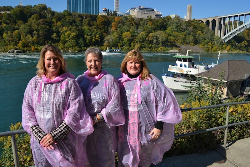 Breast cancer survivors go pink for the Maid of the Mist. From left to right: Terry Aloian, Maid of the Mist receptionist; Marjorie Ruddy, wife of Tim Ruddy, Maid of the Mist vice president for marketing; and Paula Fiore, daughter of Maid of the Mist chairman and CEO James V. Glynn.