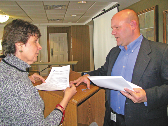 Tony Surace of Grand Island, Niagara Falls Memorial Medical Center's director of sports medicine and Summit Rehab manager, talks with Roberta Brown at the hospital's recent edition of its luncheon speaker program at Elderwood Residences at Wheatfield.