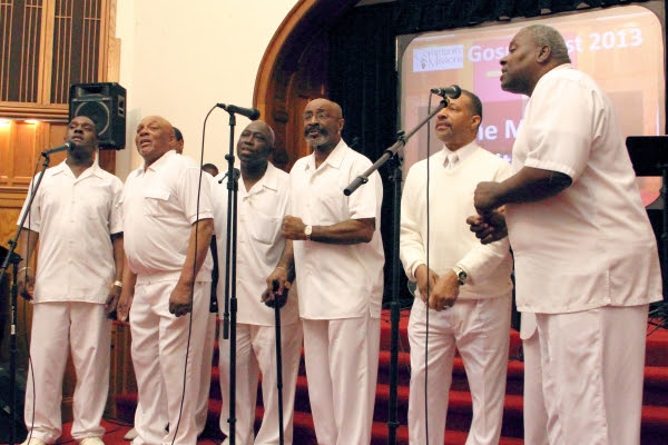Men in White Choir members performing at Community Missions' 2013 Gospel Fest held at First Baptist Church in Niagara Falls.