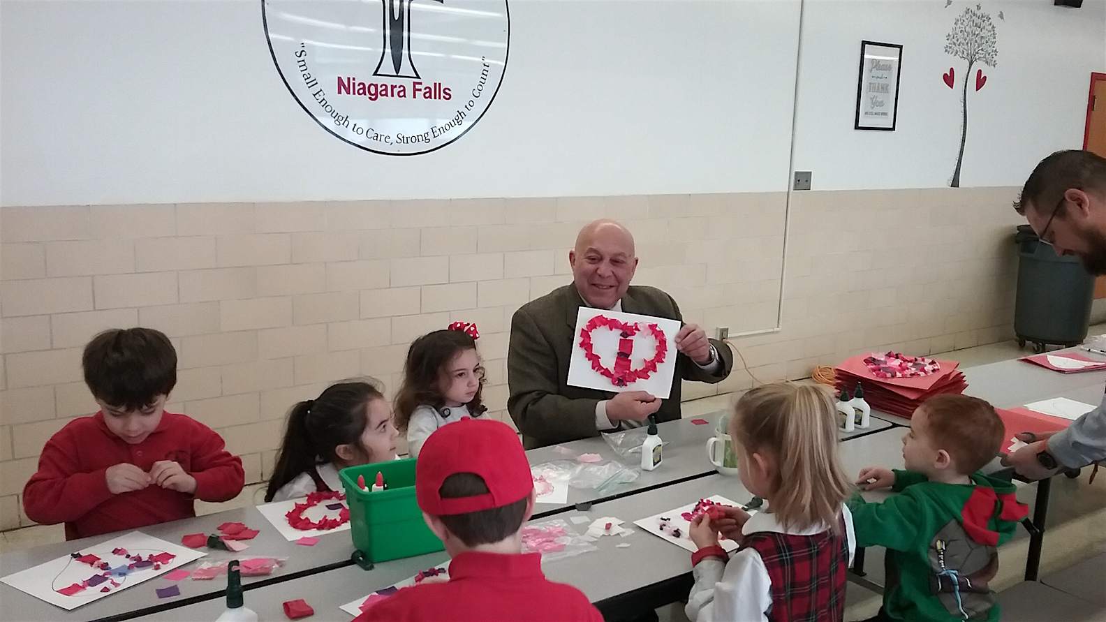Assemblyman Angelo J. Morinello hosted his first annual `Valentines for Seniors` program at Catholic Academy in Niagara Falls. Pictured around the table, clockwise: Joseph Dzielski, Ryker, Ella, John, Brayden, Samantha, Audrey and Morinello.