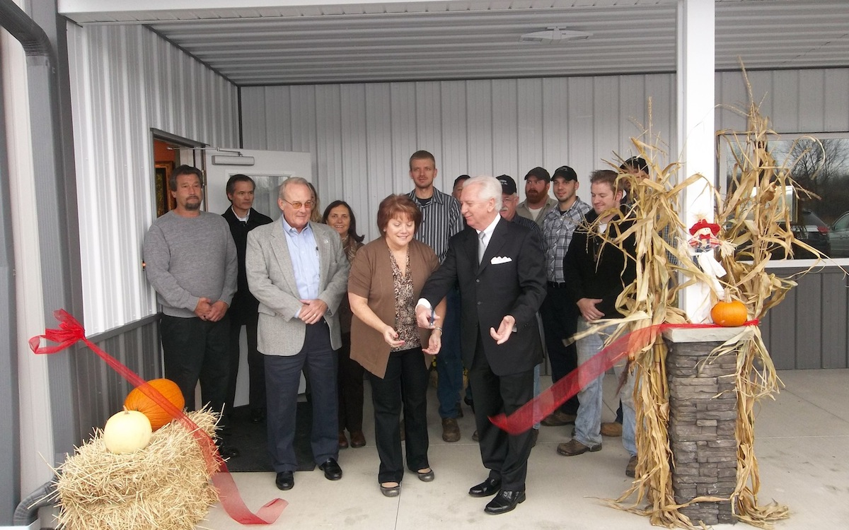Henry M. Sloma, chairman of the Niagara County Industrial Development Agency, and Sharon Brown, president of Brown Electric, unveil the company's new 8,500-square-foot facility in the Town of Pendleton.