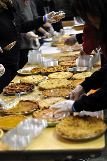 Many hands working together to prep pies at last year's