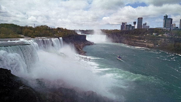 Shown is Niagara Falls, as seen from the Observation Tower. A historic Maid of the Mist boat is seen in the distance, headed into the mighty falls. (Photo by Lauren Zaepfel)