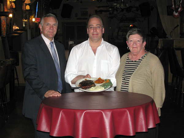 Niagara Falls Memorial Medical Center President and CEO Joseph Ruffolo, left, Bakery Restaurant & Lounge proprietor Dave Young and Medical Center Auxiliary Past President Mary Norton sample the fare to be served from 4-8 p.m. Monday at the `Famous Rib & Chicken Dinner.`