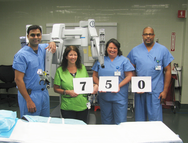 Pictured, from left: Dr. Bala Thatigotla, Medical Assistant Noel Fotus, Director of Surgical Services Shelly Meigs, R.N., and Surgical Technician Robert Abrams gather around SAL, a da Vinci robotic surgery system, to celebrate the 750th robotic surgery performed at Niagara Falls Memorial Medical Center.