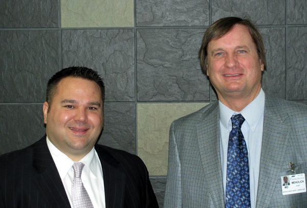 Pictured from left are Douglas Mooradian and Dr. Alan Meholick.