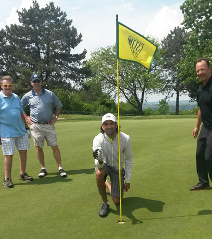 Pictured, from left, Dr. Parag Desai, kneeling, and members of his Keystone Healthcare Management team celebrate Desai's hole-in-one.