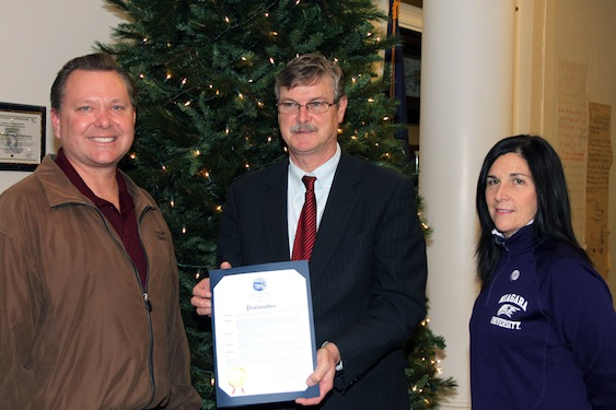Pictured, from left: Grant Babcock, director of operations for Community Missions of Niagara Frontier Inc.; Niagara Falls Mayor Paul Dyster; and Christine S. O'Hara, executive director for alumni engagement at Niagara University.