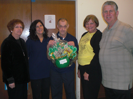 Showing off one of the theme baskets from the Baskets O'Plenty Auction are, from left, Maureen Sheeran; event Chairwoman Christine S. O'Hara; Buddy Wall, who receives services from Opportunities Unlimited of Niagara; Lois Stephens; and Gary Strenkoski.
