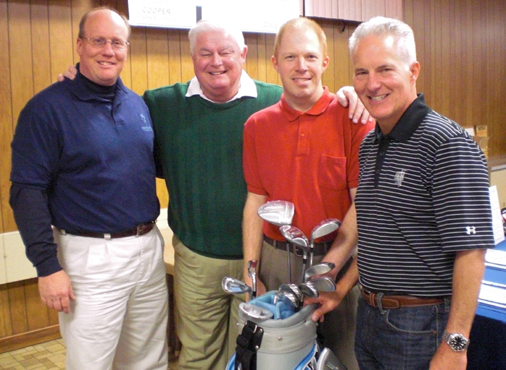 Pictured from left are OUN golf raffle emcees Dan Antonucci and Kevin O'Connell, along with Adam LaRock, who receives services from Opportunities Unlimited of Niagara, and event sponsor Michael Vitch, of Compu-Mail. The foursome is showing off a full set of golf clubs, which will be raffled off April 28 at the Sanborn Firehall.