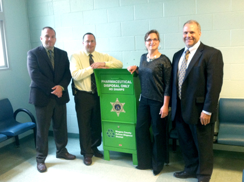 The Niagara County Sheriff's Office has installed the county's first permanent pharmaceutical waste drop-off site at the county jail. Declaring the collection point open are, from left, Undersheriff Michael J. Filicetti, Capt. Michael Dunn, Niagara County Refuse District Acting Director Dawn Timm, and Niagara County Legislature Majority Leader Rick Updegrove. The collection point is open 8 a.m. to 5 p.m. weekdays.