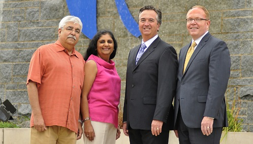 Pictured, from left: Dr. Komal and Anu Chandan, Russell Hurlburt and John Percy.