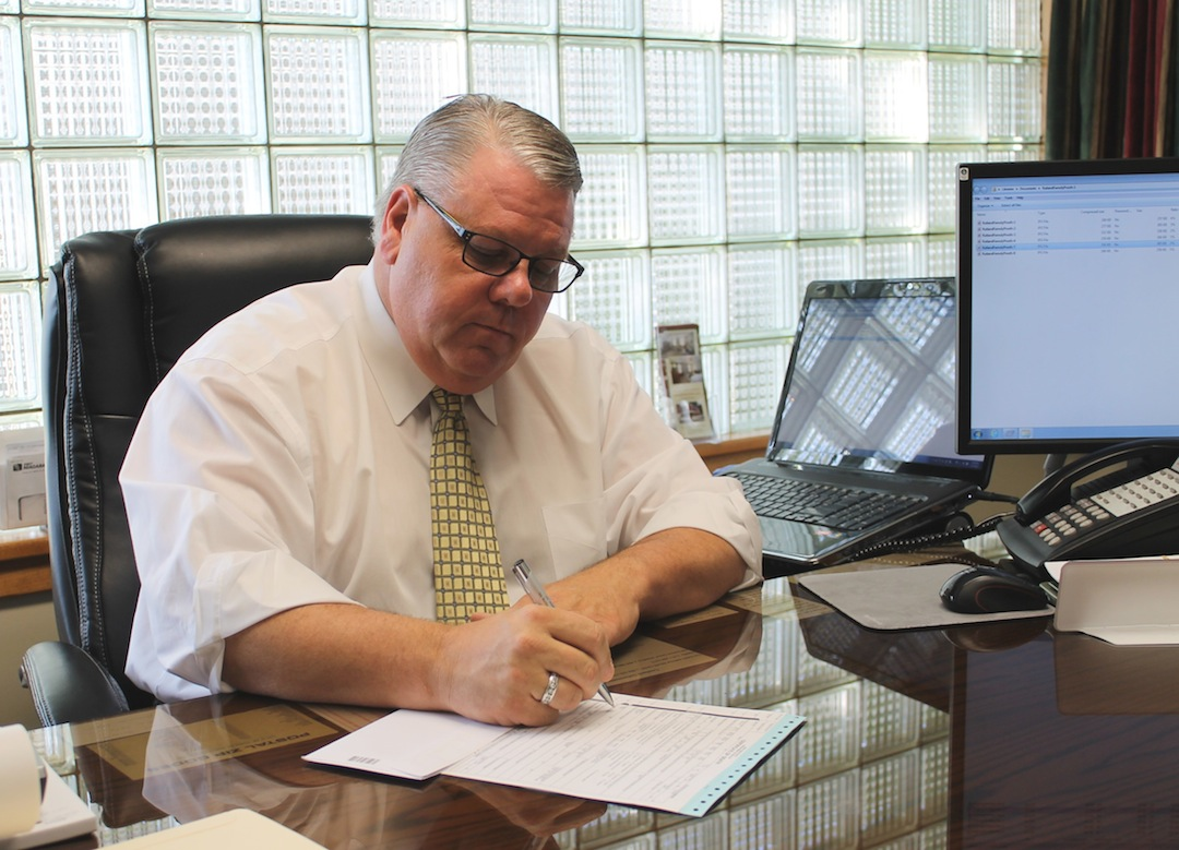 Niagara County 4th District Coroner Richard Rutland fills out a death certificate form at his office in Newfane. The newly appointed coroner, an experienced funeral director with more than 30 years in the death care industry, has spent much of the past week reviewing case files from his predecessor and becoming acquainted with the procedures of the Niagara County Coroner's Office.