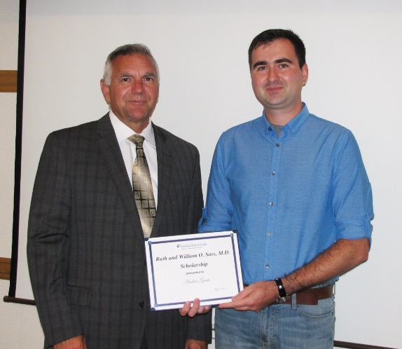 Andrei Grati, right, receives the 2015 Ruth and William O. Sass, M.D. Scholarship award from President and CEO Joseph A. Ruffolo at Niagara Falls Memorial Medical Center.