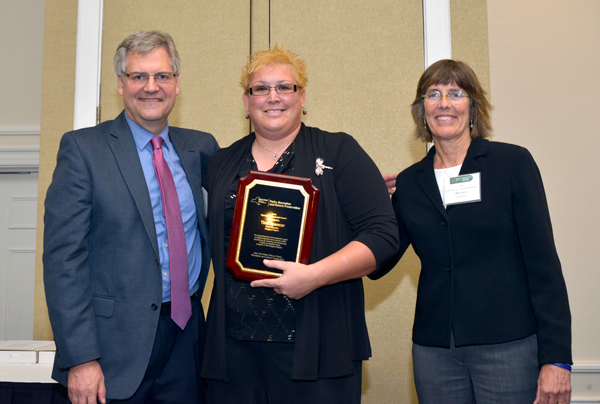 Tina Spencer, center, receives the 20165 Special Achievement Award from New York State Office of Parks, Recreation and Historic Preservation Commissioner Rose Harvey (right) and Deputy Commissioner Andy Beers (left).