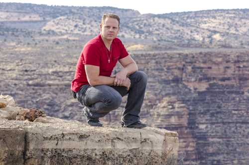 Nik Wallenda, the `King of the High Wire,` poses in front of the Grand Canyon. He crossed the `Wonder of the World` on a wire Sunday night.(Discovery Channel photo by Jason Elias)