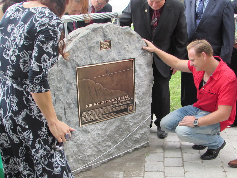 Nik Wallenda stands in front of a plaque mounted in his honor in Niagara Falls.