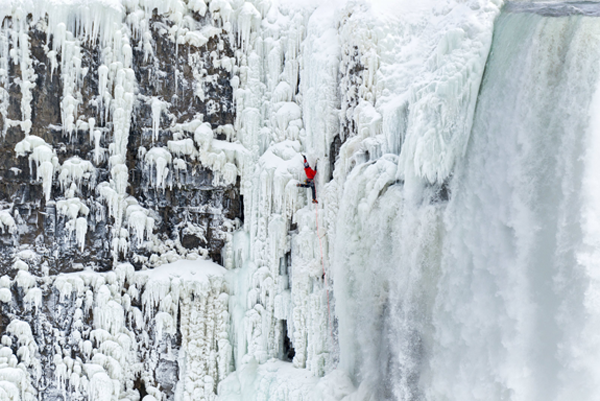 Will Gadd scales the frozen falls. Click for a larger image. (RedBull photo)