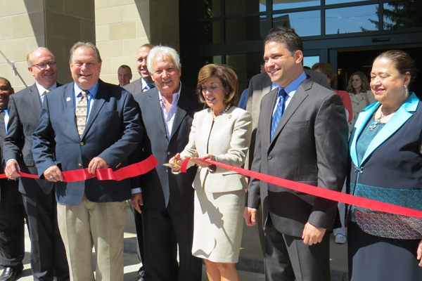 Lt. Gov. Kathy Hochul, Assemblyman John Ceretto, elected leaders, tourism agency heads and members of the Strangio family cut the ribbon at the new, 110-room Wingate by Wyndham Hotel on Rainbow Boulevard in downtown Niagara Falls.