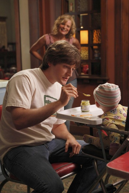 `Raising Hope: Virginia (Martha Plimpton, background) encourages Jimmy (Lucas Neff) to be creative when organizing the family portrait. (photo ©2010 Fox Broadcasting Co./Cr: Greg Gayne/FOX)