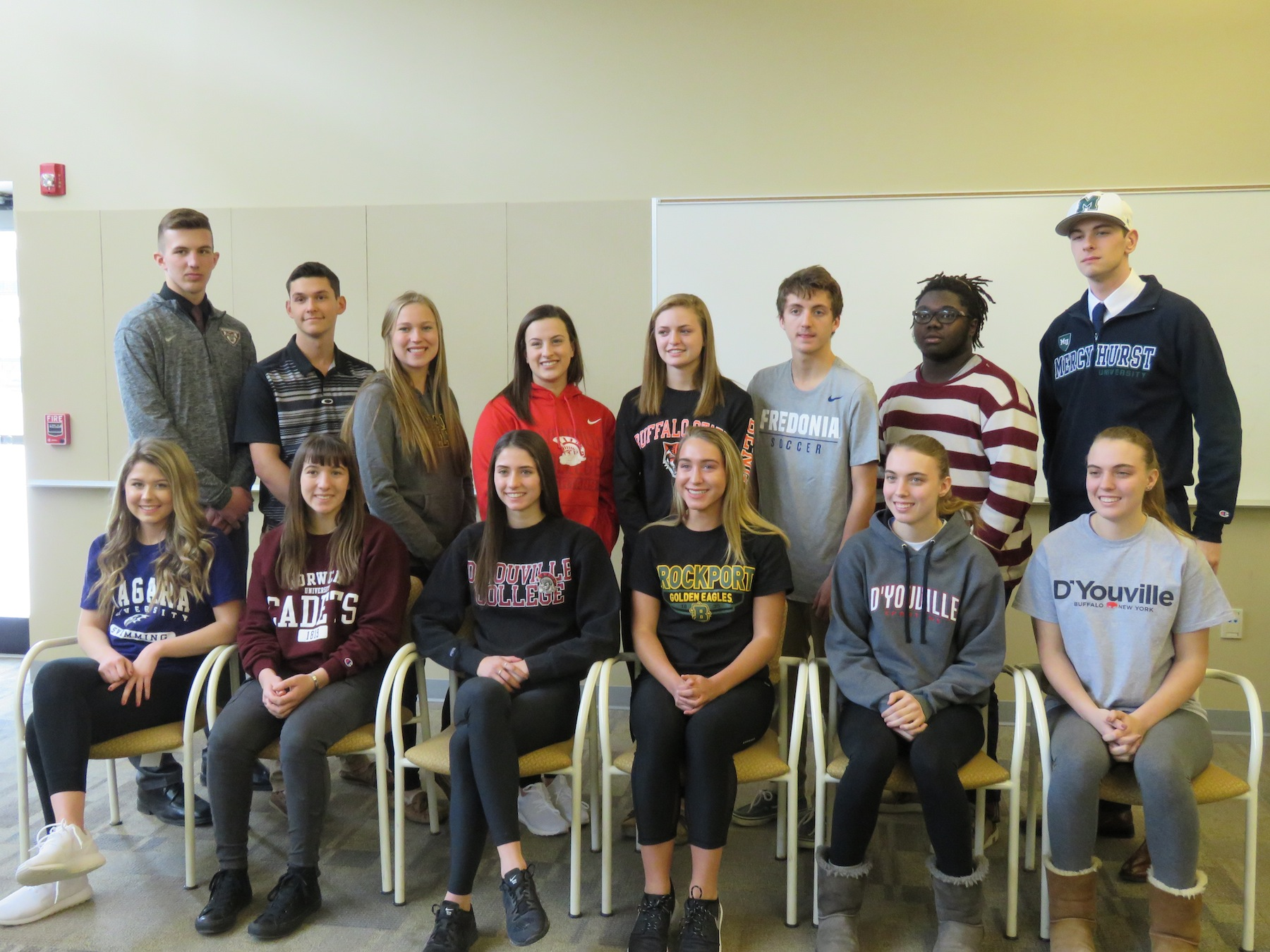 Niagara-Wheatfield student-athletes signed their letters of intent to continue their athletic careers in college. Front row, left to right; Jenna Wagoner, Sarah Carls, Tiffany Cristofanelli, Erin Wegrzyn, Carly Milleville and Mikaela Milleville. Back row, left to right; Zack Belter, Kyle Stenzel, Hallie Dworzanski, Julia Cimino, Sydney Watters, Joseph Gioannini, Josh Brown and James Filippelli. (Photo by David Yarger)