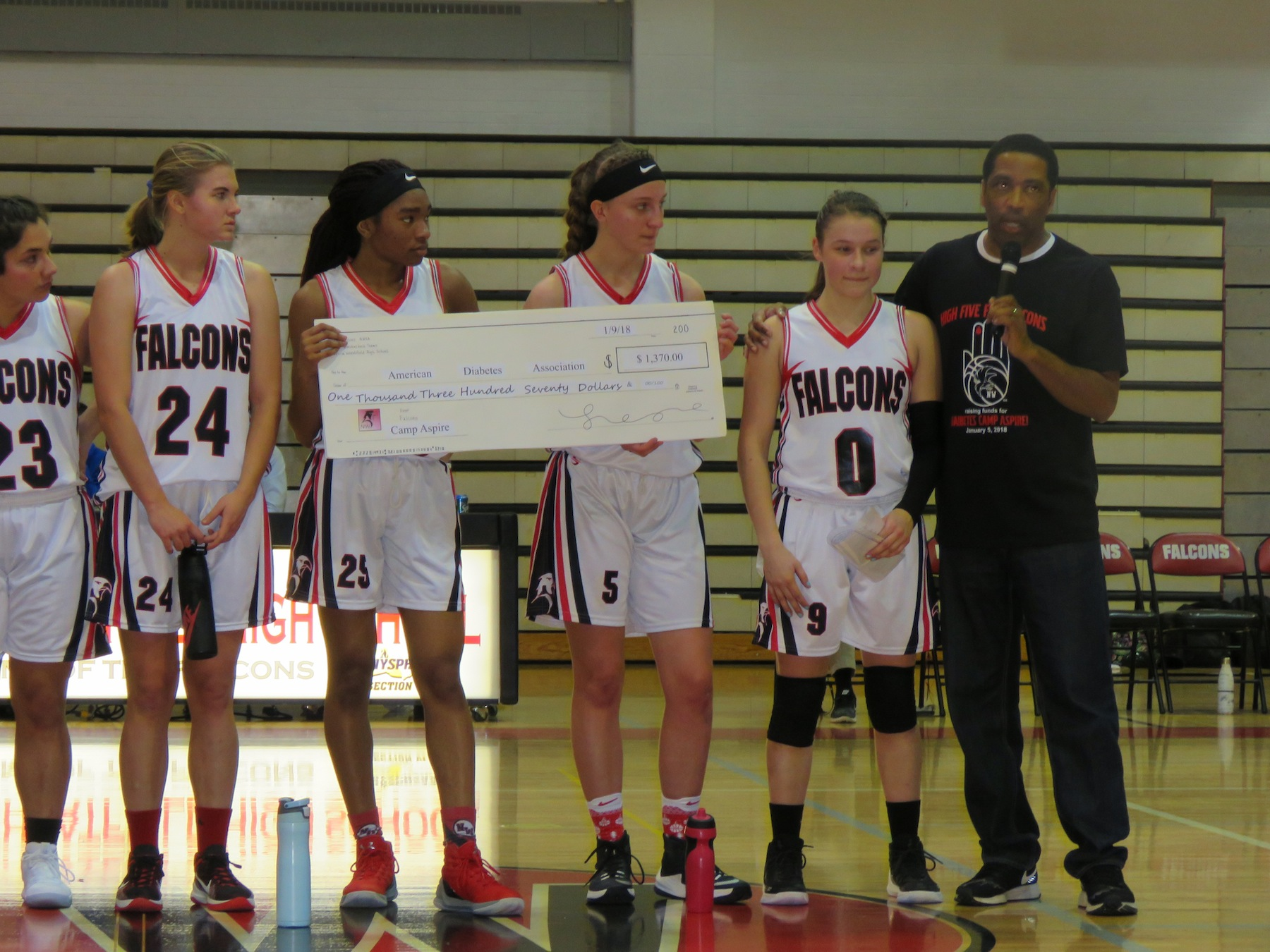 The Niagara-Wheatfield girls basketball team makes a donation to the American Diabetes Association. From left to right: Tara Perrault, Brianna Zayatz, LeGary Jackson, Emma Carrier, Kelsey Lachowski and coach Gary Jackson. (Photo by David Yarger)