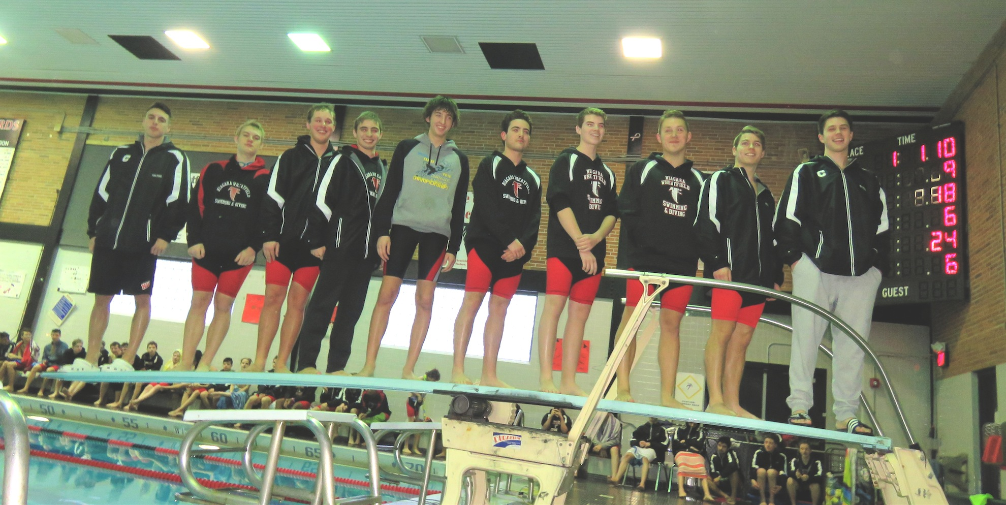 The 10 seniors from the Niagara-Wheatfield boys swimming and diving team stand atop the diving board.