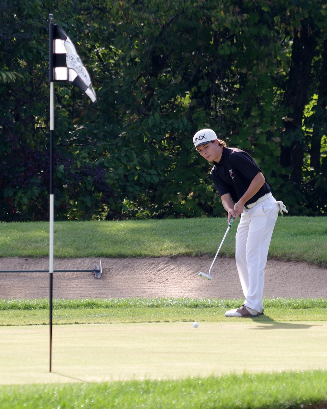 Niagara-Wheatfield Falcons golfer Nick Peters putts on the first green at River Oaks Golf Club during a match Sept. 20 against Grand Island. (Photo by Larry Austin)