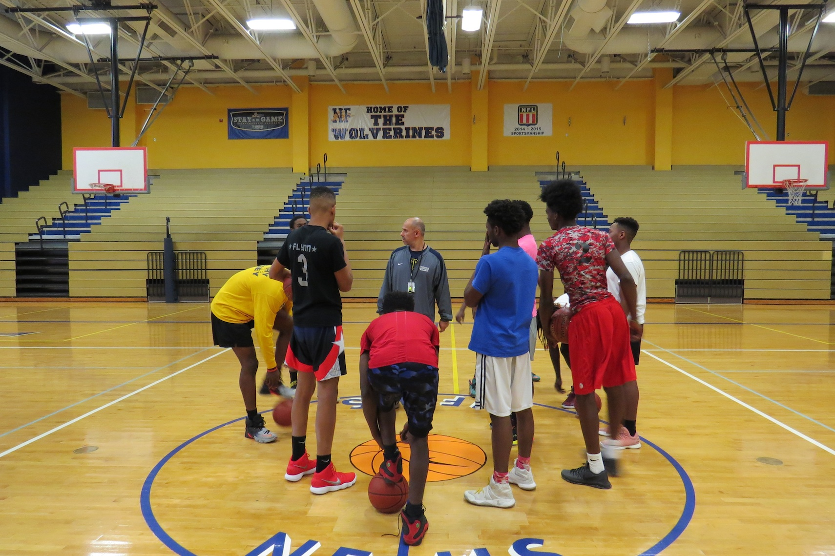 Coach Sal Constantino addresses his team prior to Tuesday's practice. Constantino is now in his eighth year as head coach of the Niagara Falls program. (Photo by David Yarger)