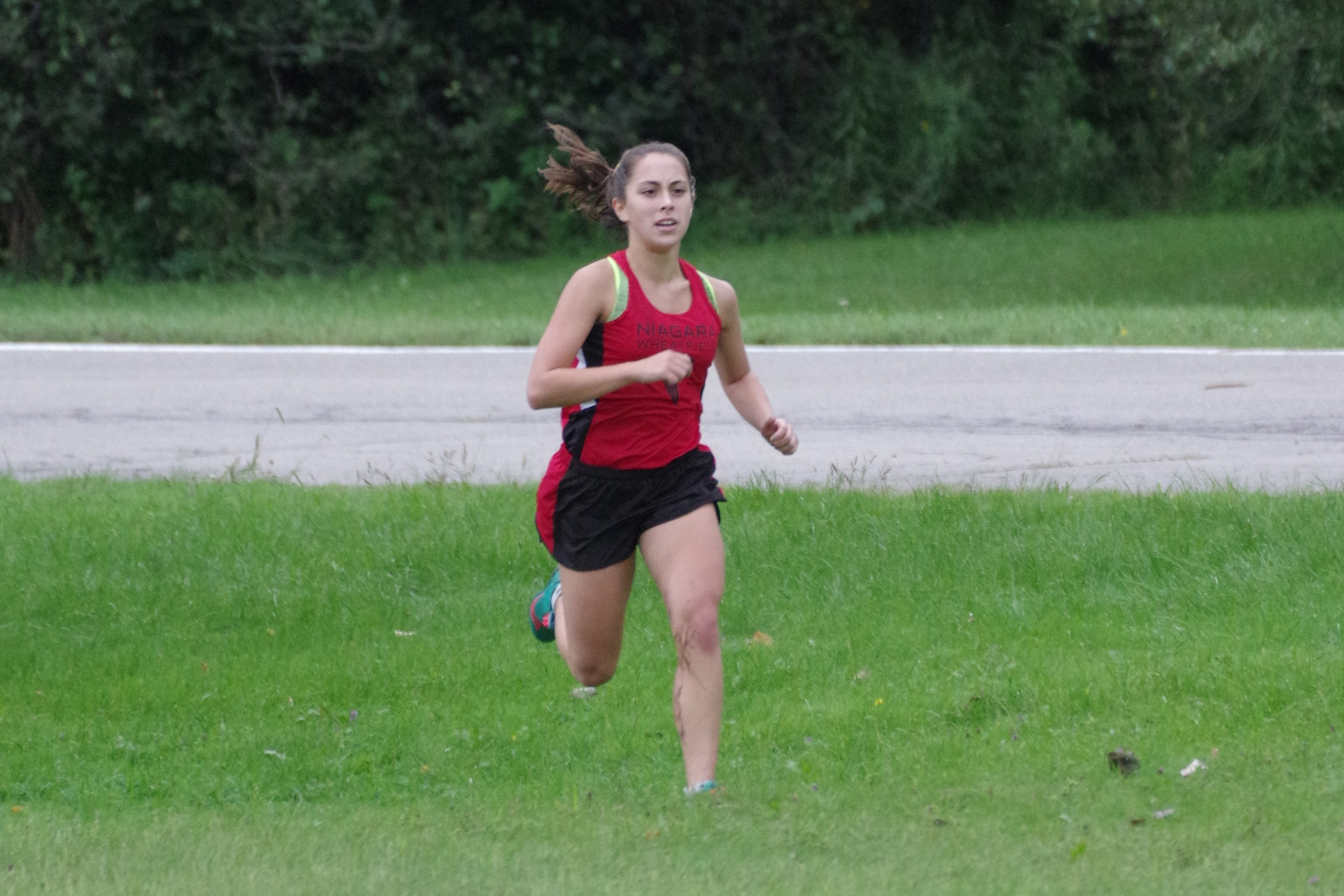 Victoria Achtziger-Hughes runs in a recent cross country meet. (Photo by Larry Austin)