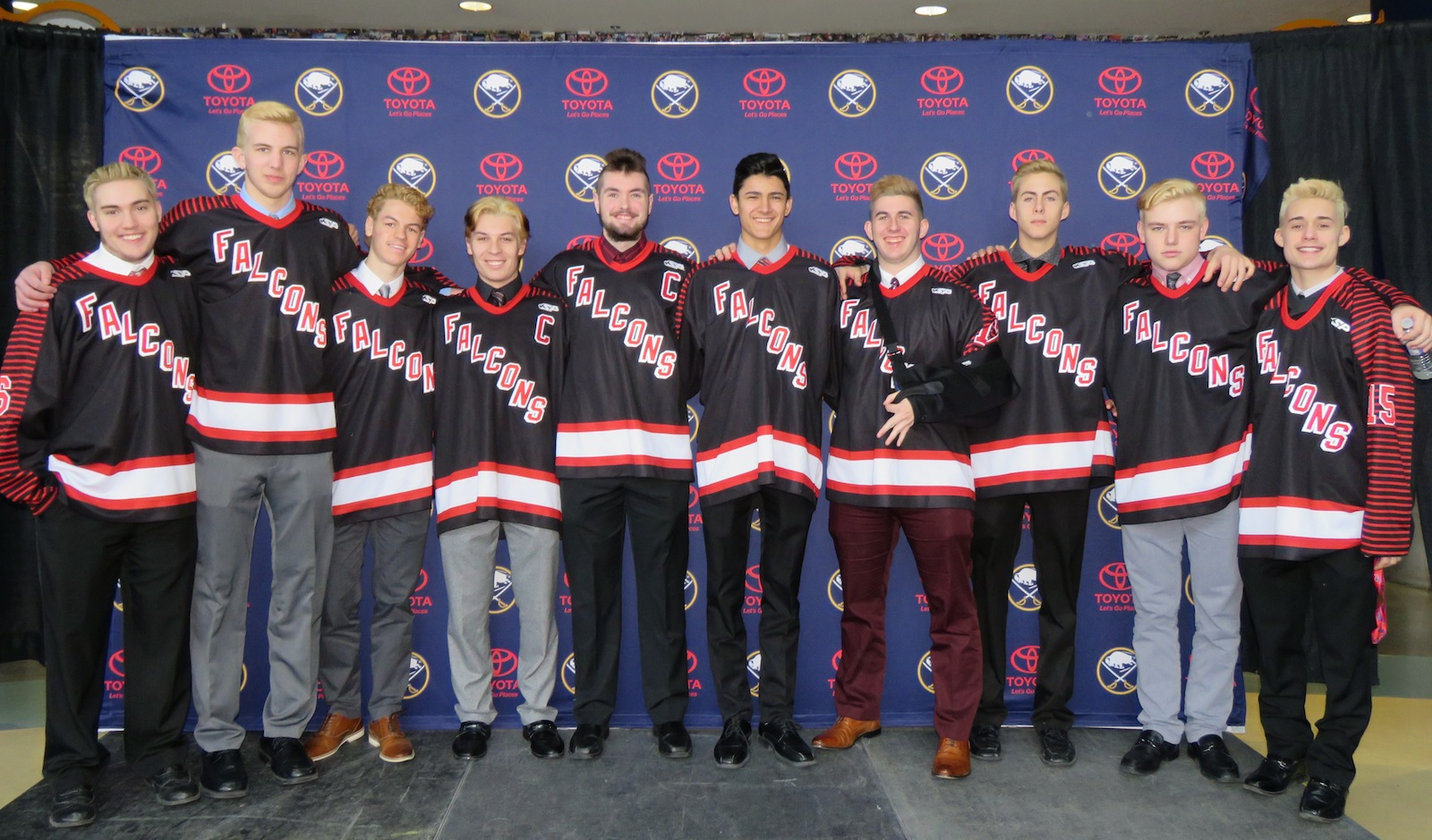 Teammates from the Niagara-Wheatfield Falcons hockey team pose for a picture Friday morning at the KeyBank Center. From left to right, Peter Buffone, Zack Belter, Michael Lotempio, Nick Peters, Christopher Tobey, Chace Woods, Sam Messana, Peyton Siegmann, Nick Breier and Dom Pulli. (Photo by David Yarger)